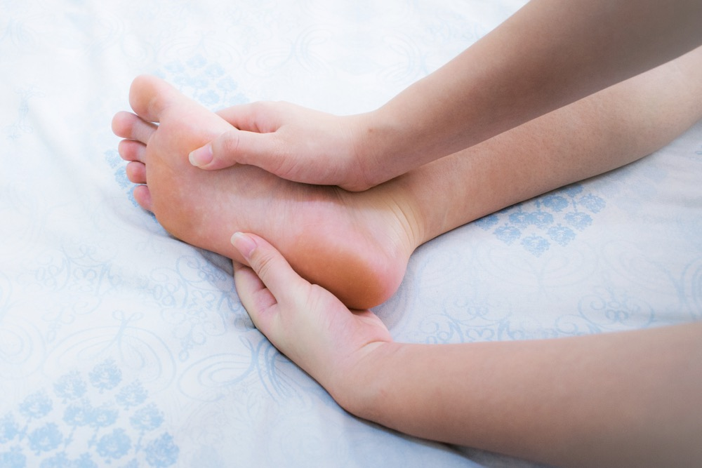 Foot massage of an adult that represents three ways to relieve neuropathy foot pain in an article by Life Renew and Neuropathy Treatment Group